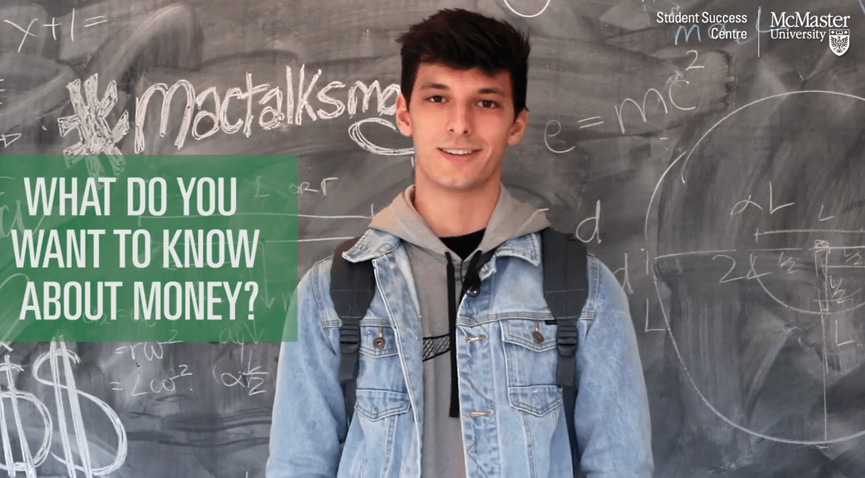 Image of student in-front of chalkboard with the question, What do you want to know about money?