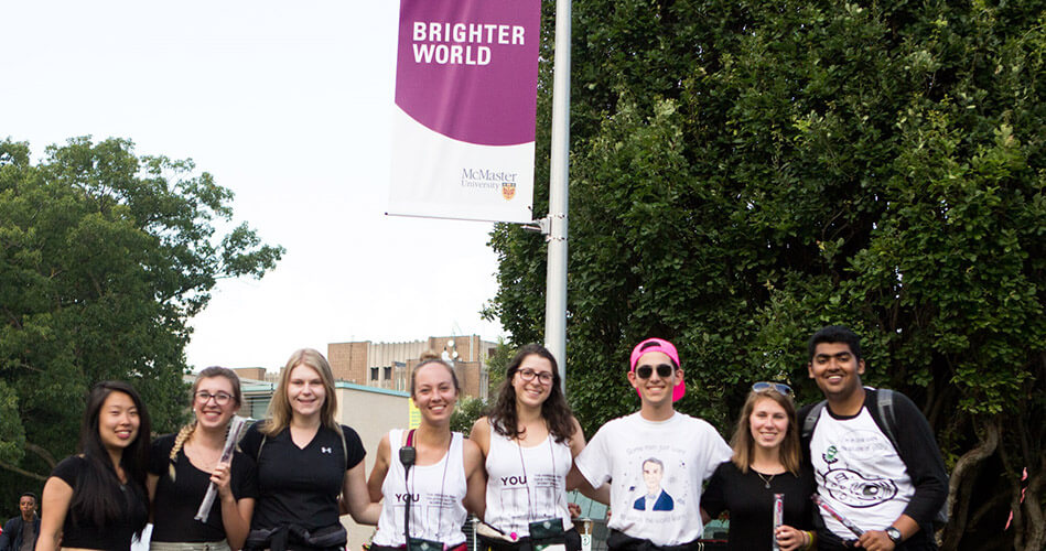 Image of students posing in-front of Brighter World sign